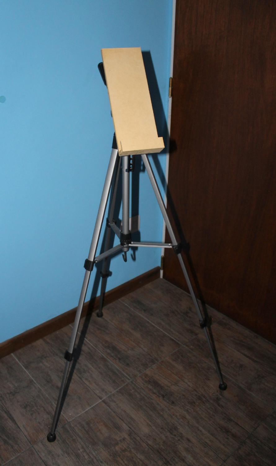 converting a camera tripod into an easel